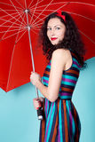 Brunette pin up model posing wearing striped dress Stock Images