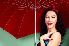 Brunette pin up model posing wearing striped dress Royalty Free Stock Photo