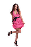 Brunette in a pink dress Royalty Free Stock Images