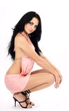 Brunette in a pink dress stock photography