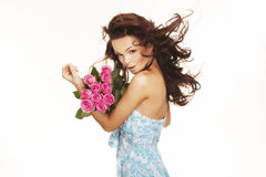 Brunette with pink roses Stock Photo