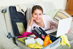 Brunette planning vacation with notebook Stock Photos