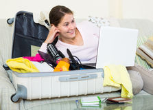 Brunette planning vacation with notebook Royalty Free Stock Images