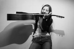 Brunette playing with guitar black and white Royalty Free Stock Image