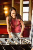 A brunette playing table football Royalty Free Stock Photos
