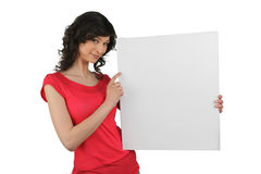 Brunette pointing to advertising board Stock Photography