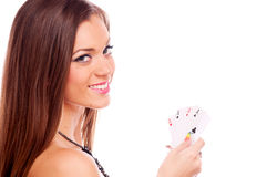 Brunette with poker of aces Royalty Free Stock Photos