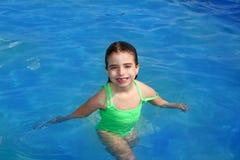Brunette pool littke girl smiling Royalty Free Stock Photography