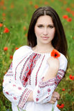 Brunette with poppy Royalty Free Stock Image