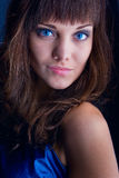 Brunette portrait. Closeup of attractive brunette with blue eyes stock photos