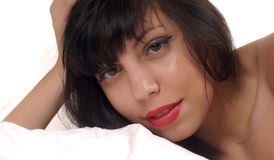 Brunette portrait. Young brunette girl posing on white background Royalty Free Stock Photo