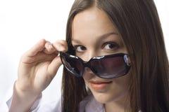Brunette portrait with sunglasses. Beautiful young brunette girl with sunglasses on white background Stock Image