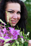 Brunette posing with a bouquet Royalty Free Stock Photography