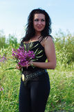 Brunette posing with a bouquet Stock Photos