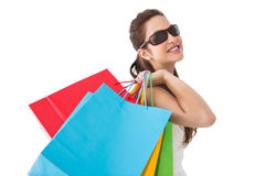 Brunette posing and holding shopping bags Royalty Free Stock Image