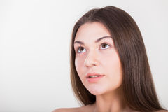 Brunette posing on a white background royalty free stock image