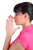 Brunette praying Stock Photography