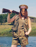 Brunette pretending to be a soldier Royalty Free Stock Image