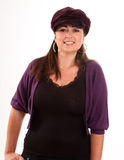 Brunette with purple cap Royalty Free Stock Images