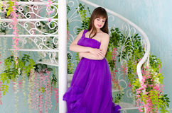Brunette in purple long dress Royalty Free Stock Photos