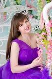 Brunette in purple long dress Stock Photos