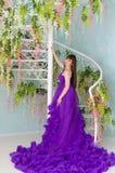 Brunette in purple long dress Stock Photography