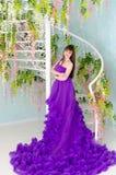 Brunette in purple long dress Stock Image