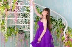 Brunette in purple long dress Stock Images