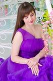 Brunette in purple long dress Royalty Free Stock Image
