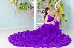 Brunette in purple long dress Stock Photo