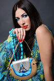 Brunette with purse Royalty Free Stock Photography