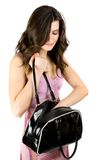 Brunette with purse Stock Image