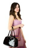 Brunette with purse Stock Photos