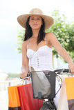 Brunette with push bike royalty free stock image