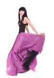 Brunette que twirling em seu vestido da cor Fotos de Stock