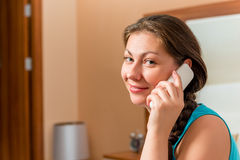 Brunette with a radio telephone handset Stock Photos