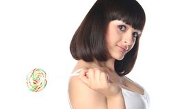 Brunette with rainbow lollipop Stock Photography
