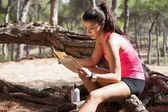 Brunette reading map wih gps watch Stock Photos