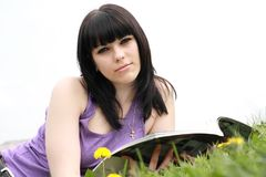 Brunette reads journal Stock Photography