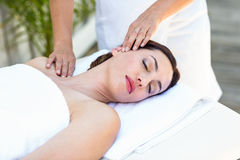 Brunette receiving neck massage Stock Photo