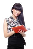 Brunette with  red book Stock Photos