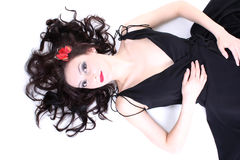 Brunette with red butterfly lying Stock Photo