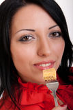 brunette in red, with a delicious slice Stock Image
