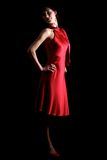 Brunette in red dress Stock Photography