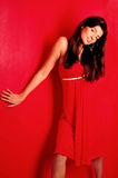 Brunette in a red dress Royalty Free Stock Photo