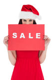 Brunette in red dress holding sale sign Royalty Free Stock Image