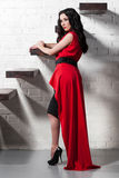 Brunette in red evening dress Stock Images