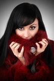 Brunette is in a red fur coat Stock Photo