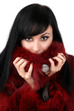Brunette is in a red fur coat Stock Photos