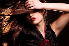 Brunette with red lips Royalty Free Stock Photography